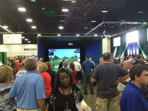 People at Event watching indoor Simulator booth