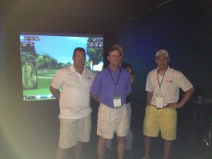 Ace Indoor Golf staff with Event Crew in front of Golf simulator