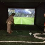 Ernest Byner trying out golf simulator